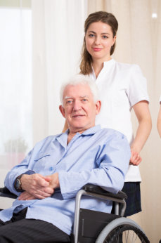 Caregiver assisting the elderly man